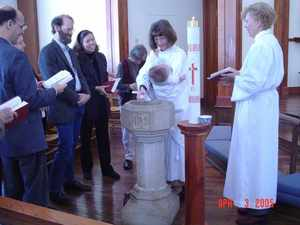 Robert's baptism at St. Lukes - photo: Steve Williams
